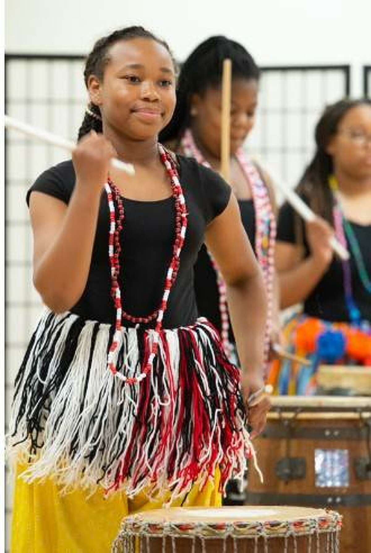 A student performs percussion in the SIUE East St. Louis Center for the Performing Arts After School program.