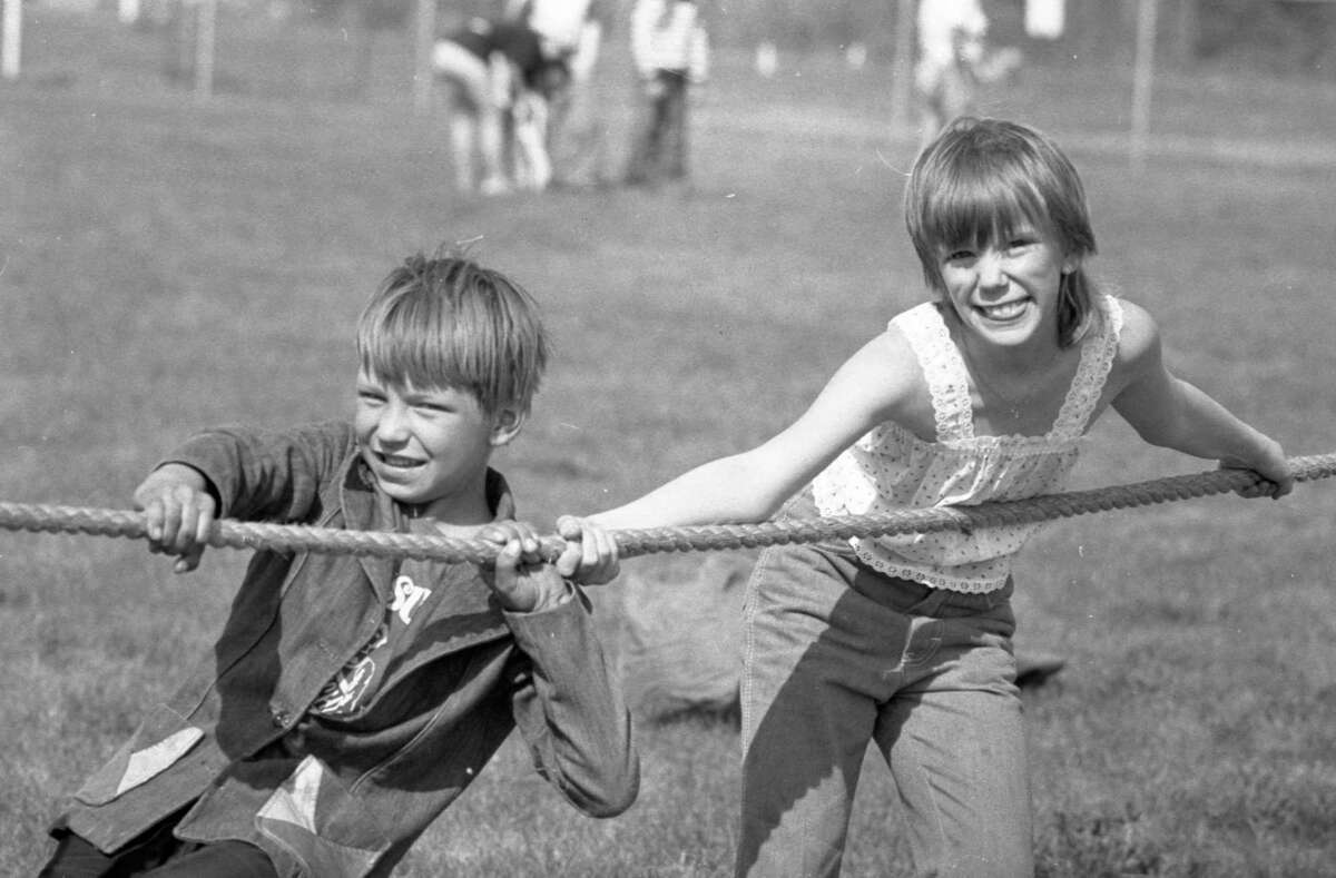 (From left) John Lucas and Traci McBee, of Wellston, participated in a game of tug-of-war at a non-competitive day for special education students at First St. Beach today. The Manistee Recreation Association sponsored the day and events included frisbee, earthball, pillow polo, baseball and others. The event was attended by students from Manistee, Mason, Benzie and Grand Traverse counties. The photo was published in the News Advocate on May 21, 1981. (Manistee County Historical Museum photo)