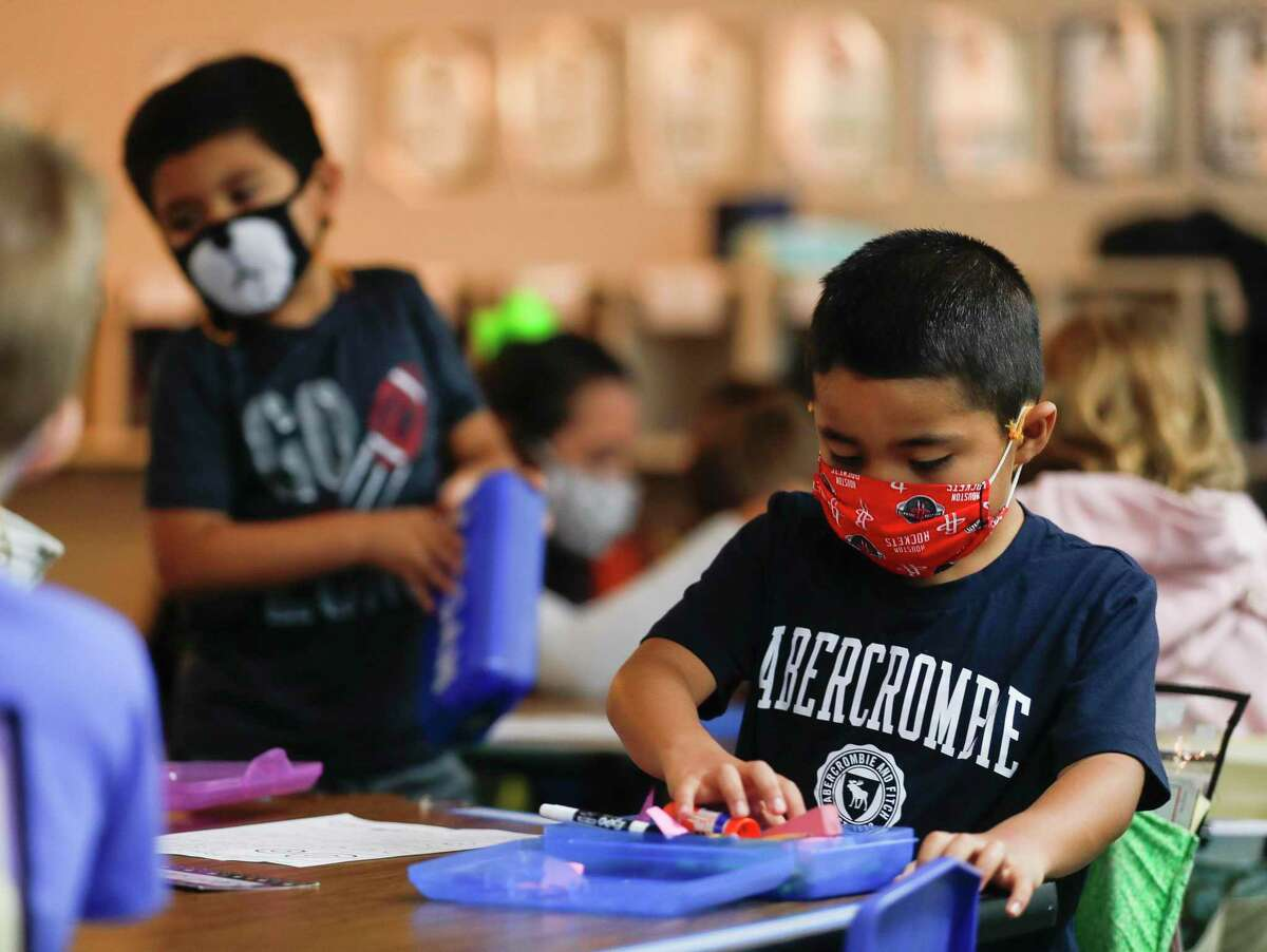 Kindergarteners wear face masks at William Loyd Meador Elementary School, Thursday, Sept. 10, 2020, in Willis.