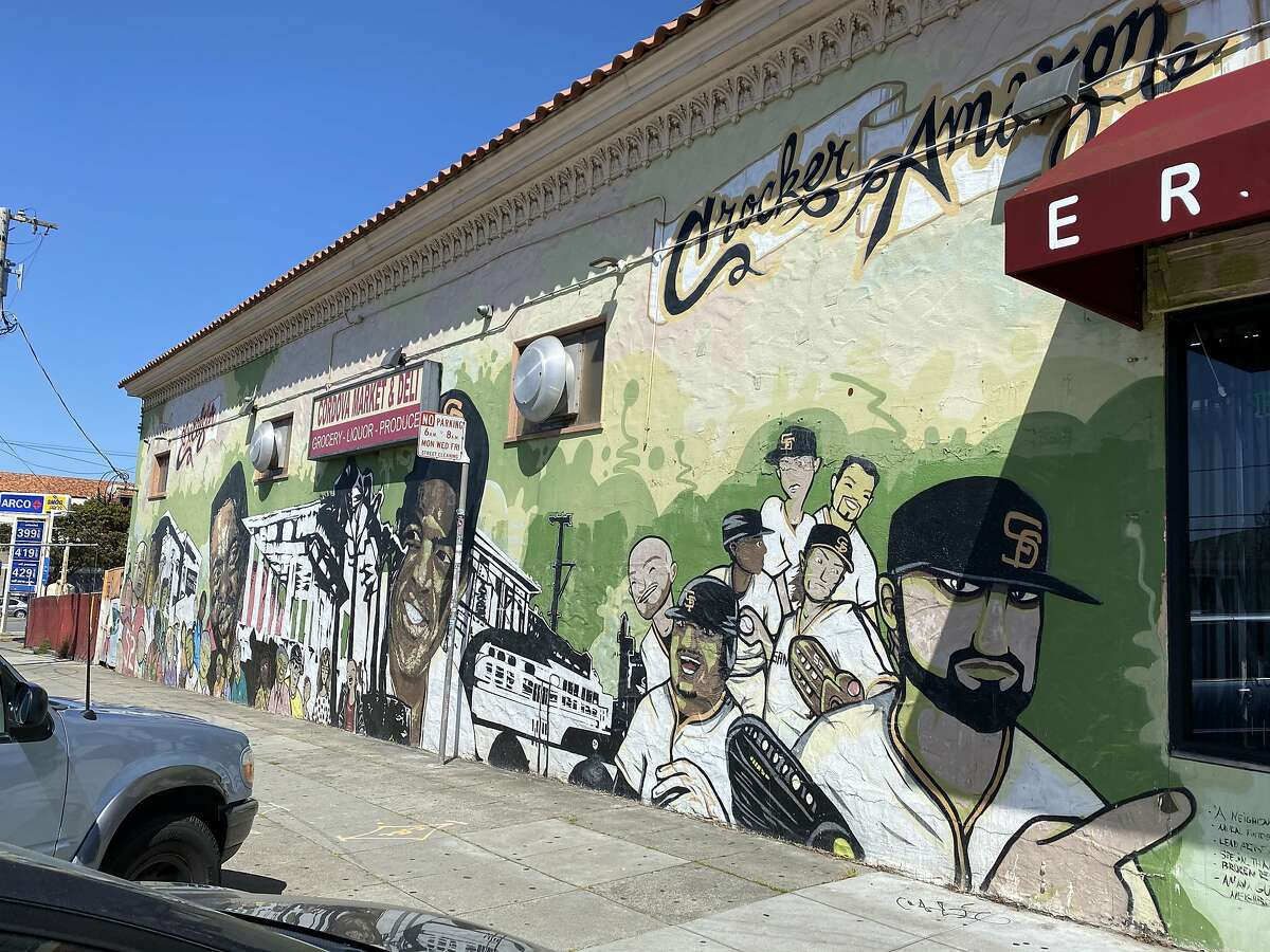 """A mural titled """"A Neighborhood Inspired by History and Champions"""" at Cordova Market & Deli in the Crocker-Amazon neighborhood."""
