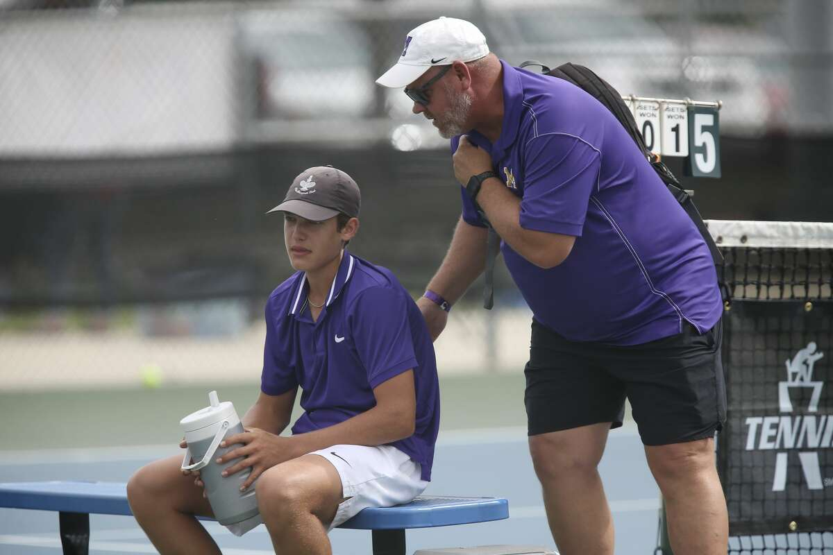 Midland's tennis head coach Tom Heiting talks with Tyler Stewart during his match against Waco Midway's Brendan Boland in the UIL District 6A Championships in San Antonio, Friday, May 21, 2021. Stewart took the title, 4-6, 6-1, 6-2.