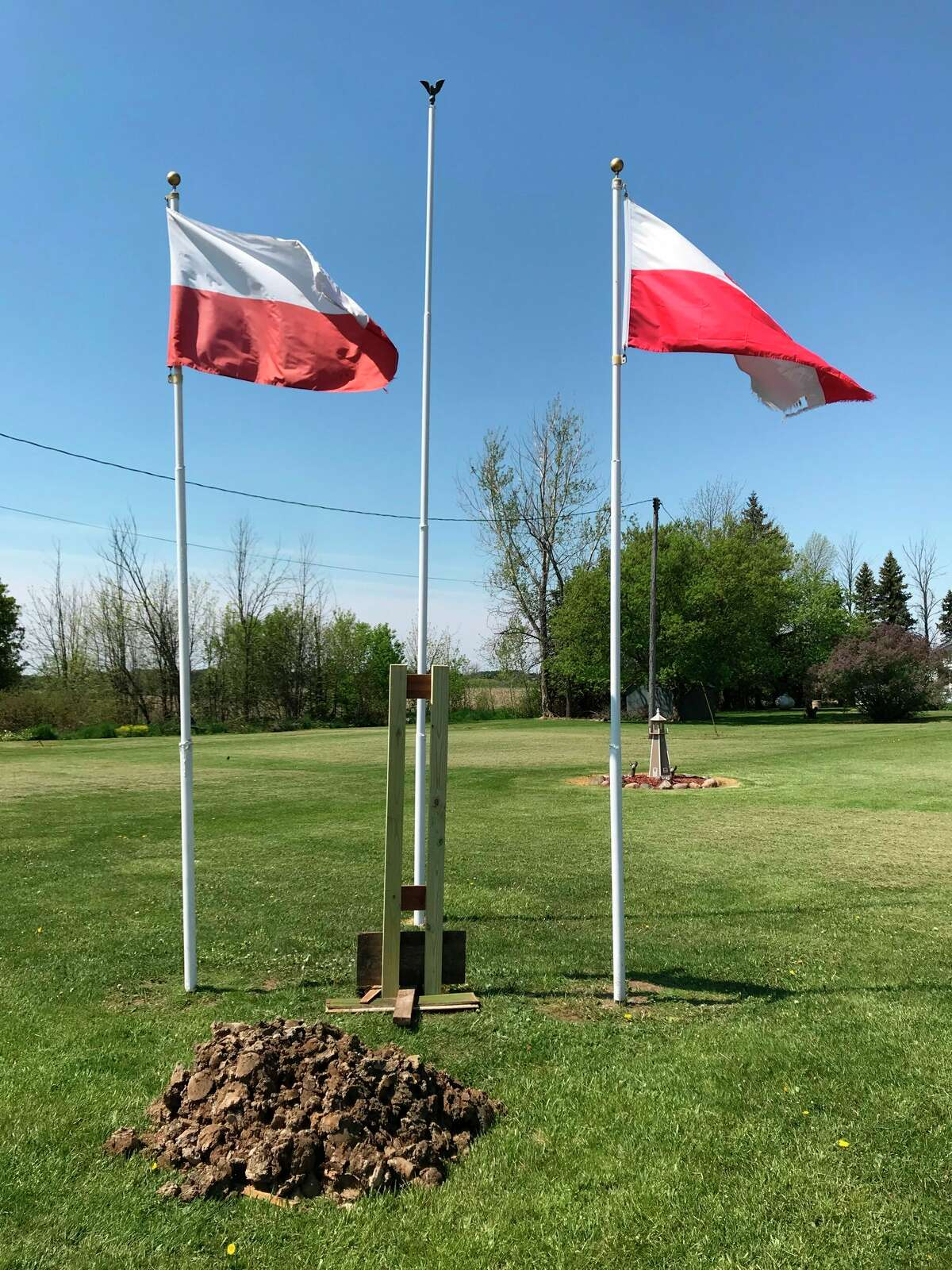 The flag poles in Parisville where a plaque honoring the area's Polish settlement will be installed. Parisville is home to the oldest Polish community in Michigan and one of the oldest in the country.(Roger Laske/Courtesy Photo)