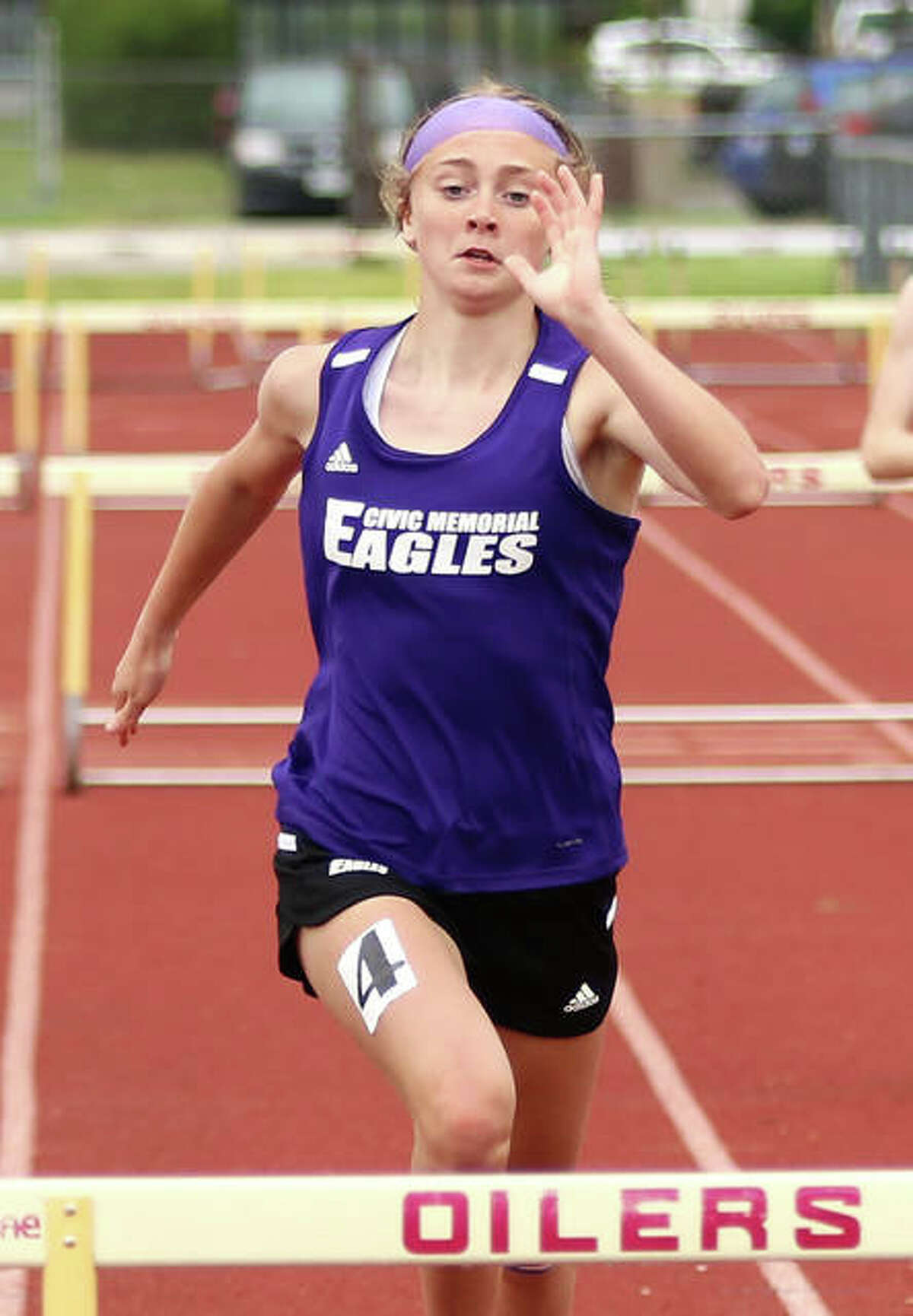 CM's Bella Dugger approaches the final hurdle in her 300-meter hurdles victory Monday at the Madison County Small-Schools girls track meet at Wood River.