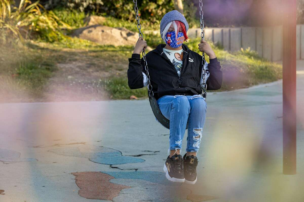 Ella Guadarrama (11) swings at the Helen Diller Playground in Mission Dolores Park on Thursday, May 20, 2021, in San Francisco, Calif.