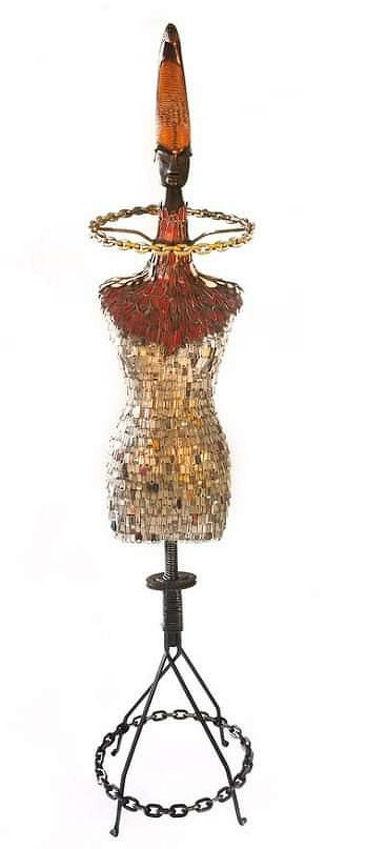 Cypress sculptor Joe Haden, a 30-year veteran of the Art Car parade in Houston and a lifetime artist, will be sharing his works of art in a solo show beginning June 5 - July 7 at the Archway Gallery, 2305 Dunlavy in Houston, just north of Westheimer. This is his piece called