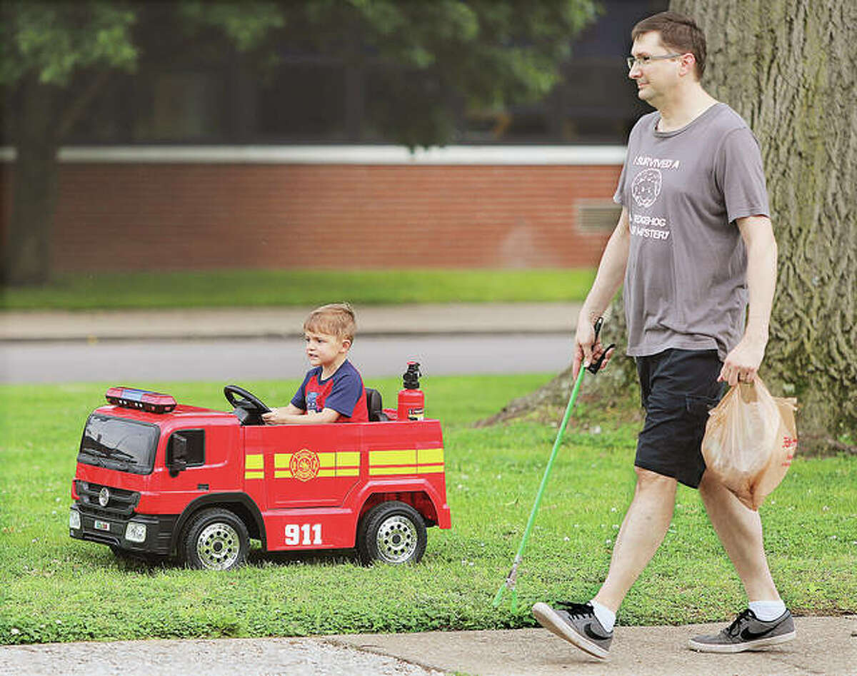 The Alton Fire Department had a new pumper truck guarding the West side of Alton. Junior firefighter Rob Lack, 4, drove his motorized fire truck along side his dad, Jason Lack, as they moved down State Street this week.
