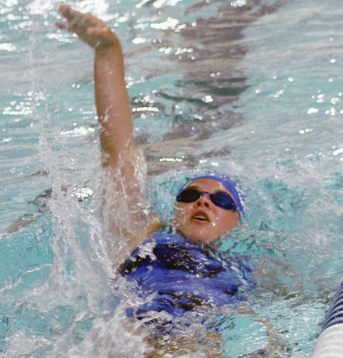 Grace Middleton of Summers Port swims the backstroke at the 2019 SWISA Swim Championships. The league has announced it will return this summer after last year's season was canceled because of the pandemic.