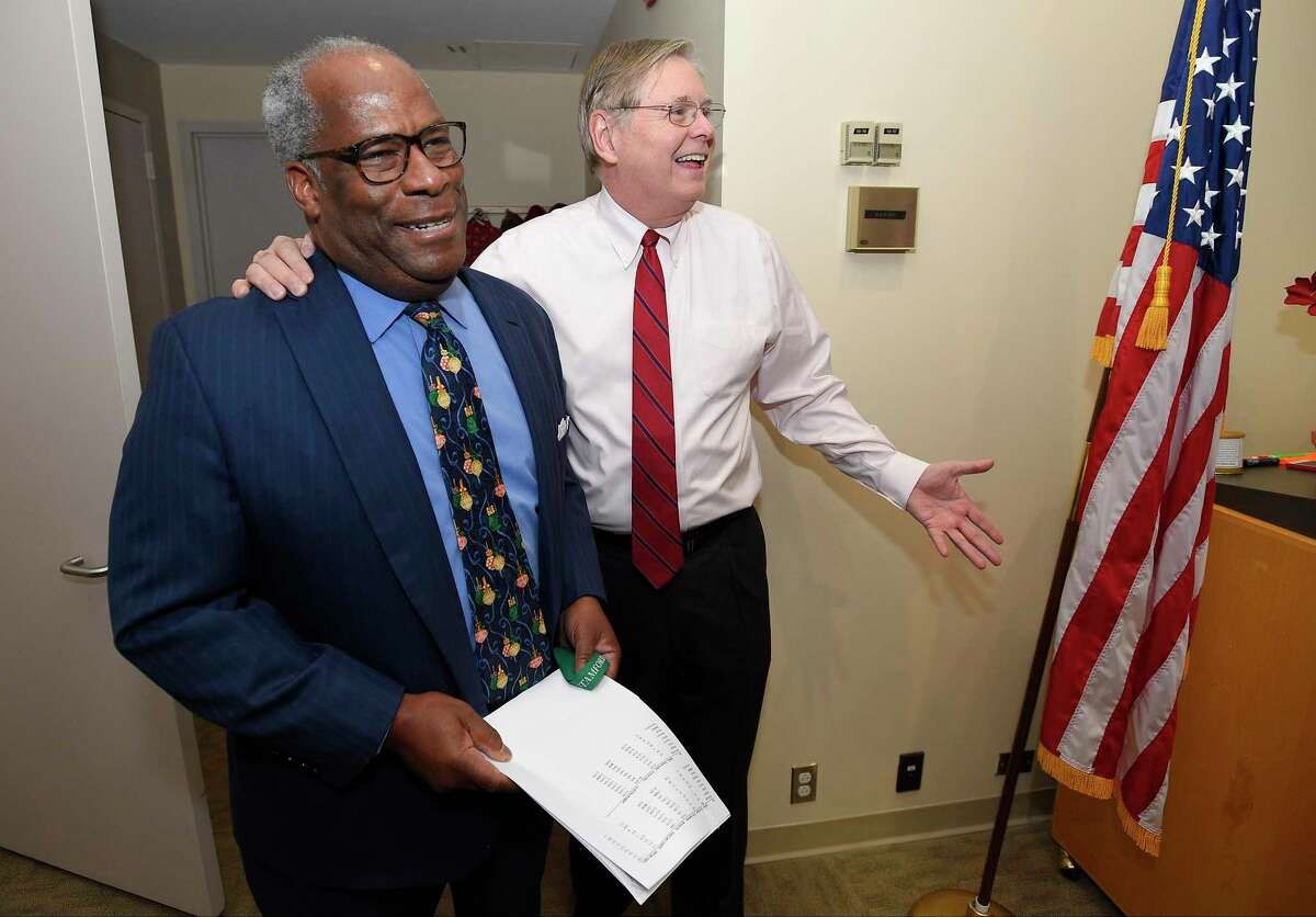 Dudley Williams, Mill River Collaborative director, left, is surprised by Stamford Mayor David Martin and many of his co-workers and friends after learning he had been named as Stamford's 2017 Citizen of the Year.