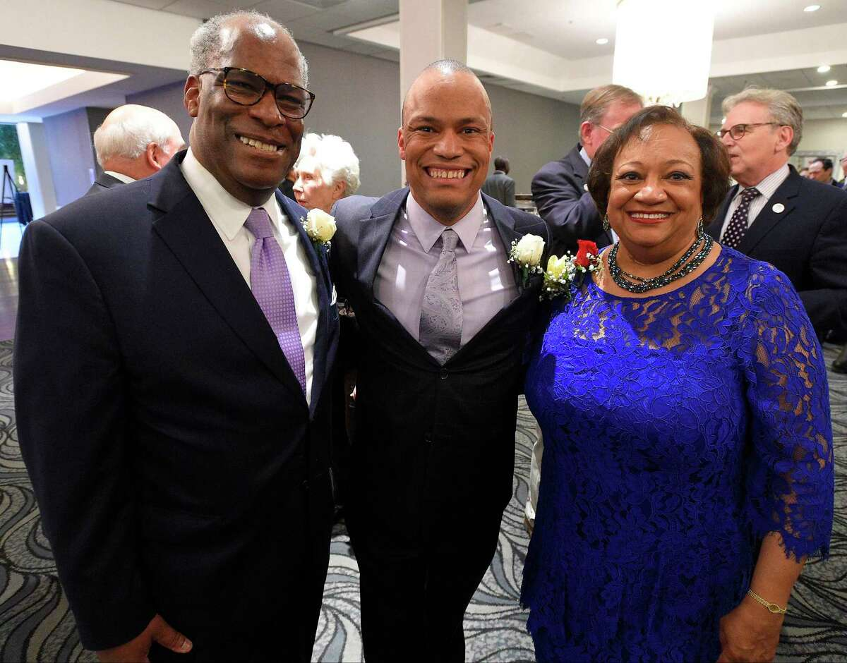 From left, Dudley Williams Jr., his son Dudley Williams III, and wife Juanita T. James, pose for a family photo prior to the Stamford's 73rd Annual Citizen of the Year dinner at the Crowne Plaza Stamford on April. 24, 2017 in Stamford, Connecticut. Along with Williams being honored as COTY, several young scholars and Veterans were recognized, with each student recipient receiving a $7,500 scholarship. The event is sponsored by the city and the Jewish War Veterans.