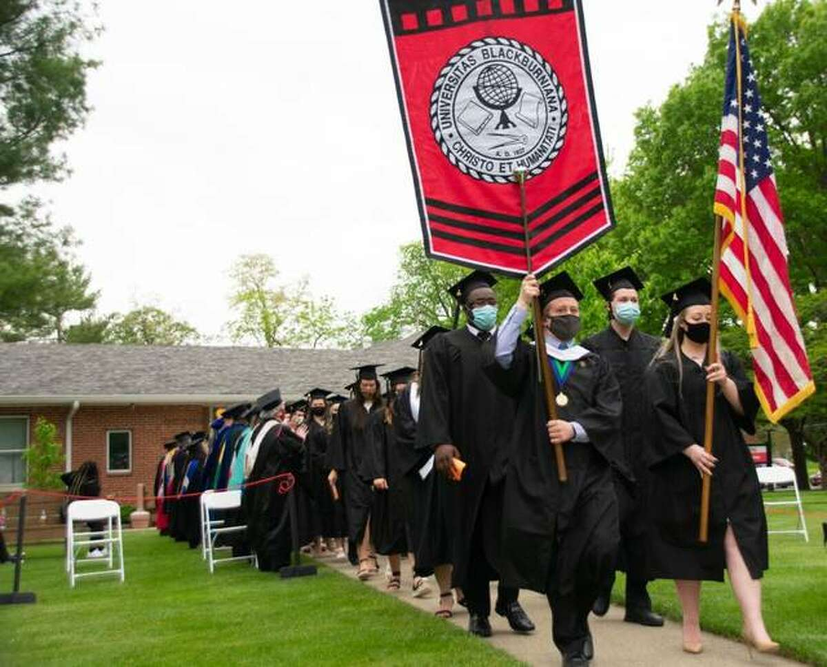 Blackburn College Class of 2021 Social Science graduates are led by 2020-2021 Student Marshal Ethan Mensing and Senior Class President Allison Kromray at May 15 commencement ceremonies.