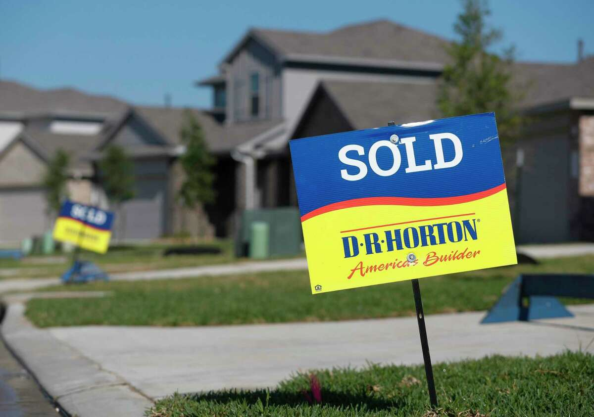 Sold signs are seen in a newly built neighborhood in Granger Pines, Tuesday, April 20, 2021, in Grangerland.