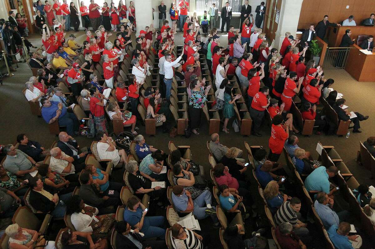 A crowd celebrates the City Council's approval of San Antonio's nondiscrimination ordinance in 2013. Jalen McKee-Rodriguez, a candidate for District 2, believes the city needs to expand the measure to include businesses and contract employers.