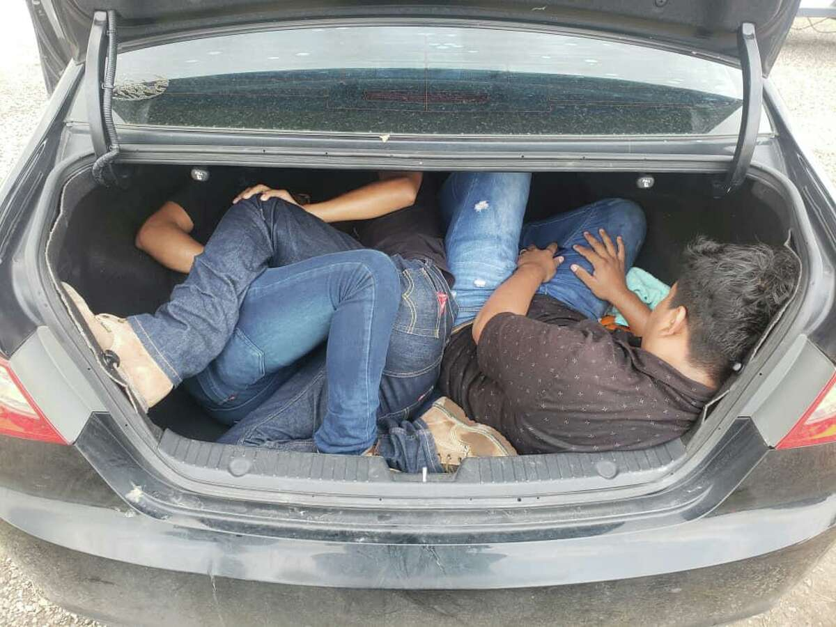 U.S. Border Patrol agents discovered these three people in the trunk of a car. They were determined to be in the country illegally.