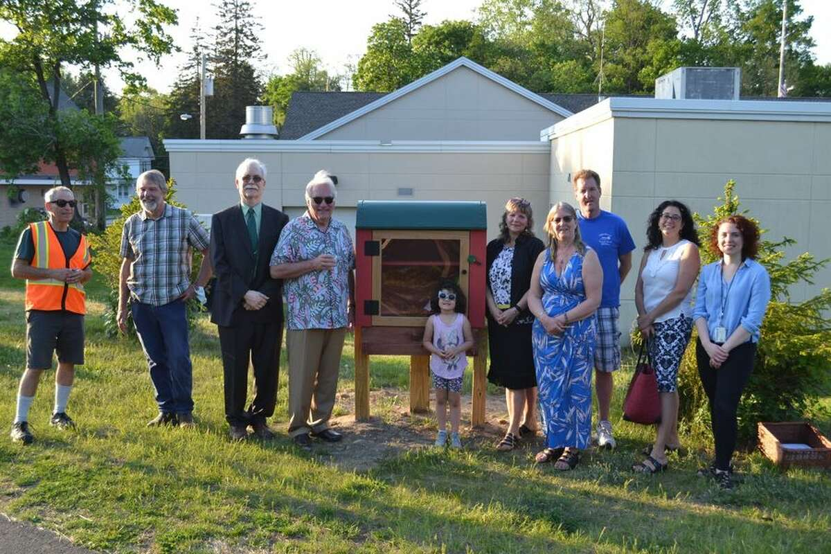 Here is a picture of the installation of Grassroot Givers' 21st Little Free Library on the Rail Trail in Slingerlands.  Pictured are Mary Partridge-Brown and Roberta Sandler, Co-Directors of Grassroot Givers