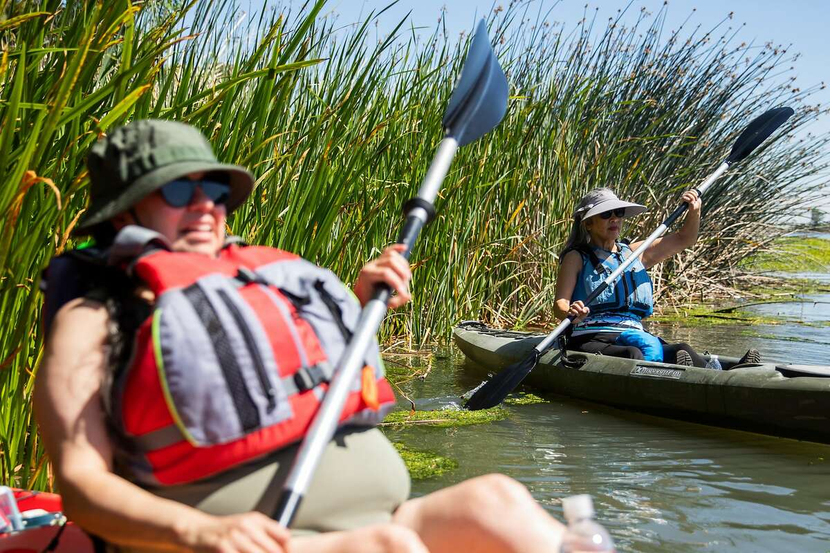Tina Ramirez (left) and Marilyn Low maneuver their kayaks out of greenery during a beginner's kayaking lesson with Kathy Bunton of Delta Kayak Adventures in Antioch, Calif. Friday, May 21, 2021. Kayaking season is upon us and there's no better place in the Bay Area to learn while getting away from the city and crowds than the delta.