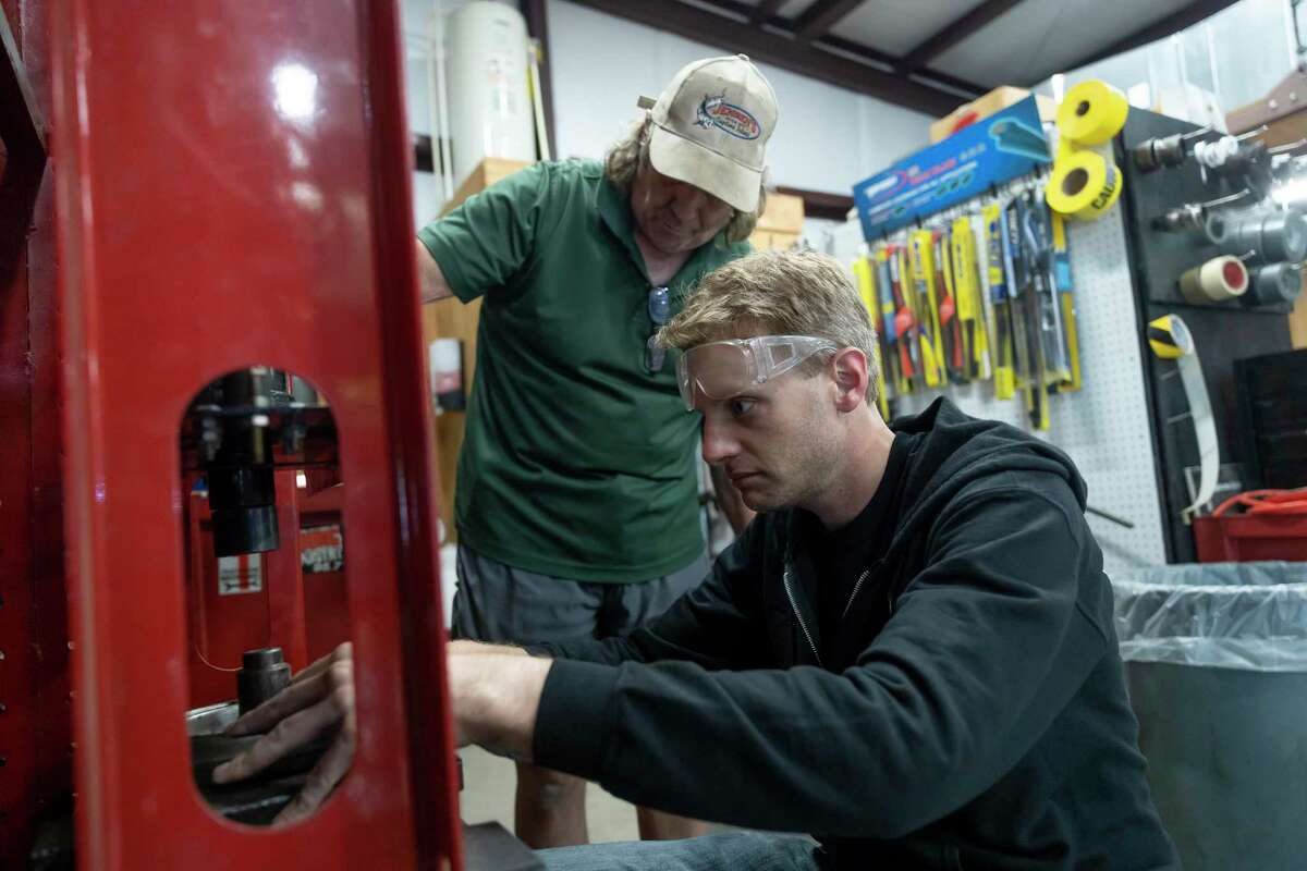 Dan Parker, right, and Larry Prahm work at God's Garage on April 16 to prepare automobile donations. Since the vaccine rollout, the garage has seen an increase in volunteers.