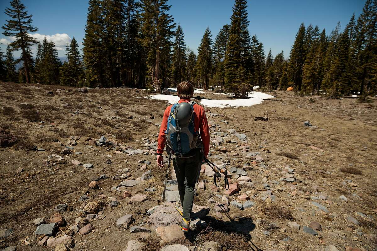Hakon Rozell of Bend (Tehama County) hikes down Olbermann's Causeway after summiting Mount Shasta.
