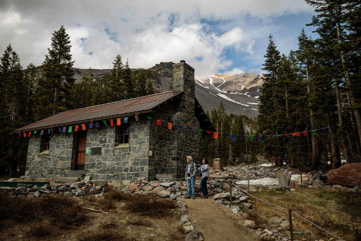 Bill and Jan Deckman of San Jose take a day hike to the Sierra Club's Horse Camp on Mount Shasta. The easily accessible mountain attracts casual hikers and novice mountain climbers.