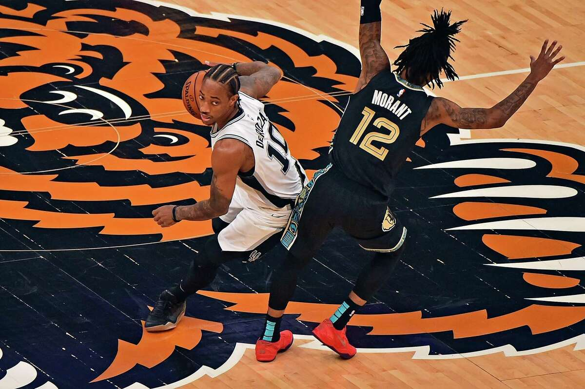 MEMPHIS, TENNESSEE - MAY 19: DeMar DeRozan #10 of the San Antonio Spurs handles the ball against Ja Morant #12 of the Memphis Grizzlies during the first half of the play-in tournament game at FedExForum on May 19, 2021 in Memphis, Tennessee. NOTE TO USER: User expressly acknowledges and agrees that, by downloading and or using this photograph, User is consenting to the terms and conditions of the Getty Images License Agreement. (Photo by Justin Ford/Getty Images)