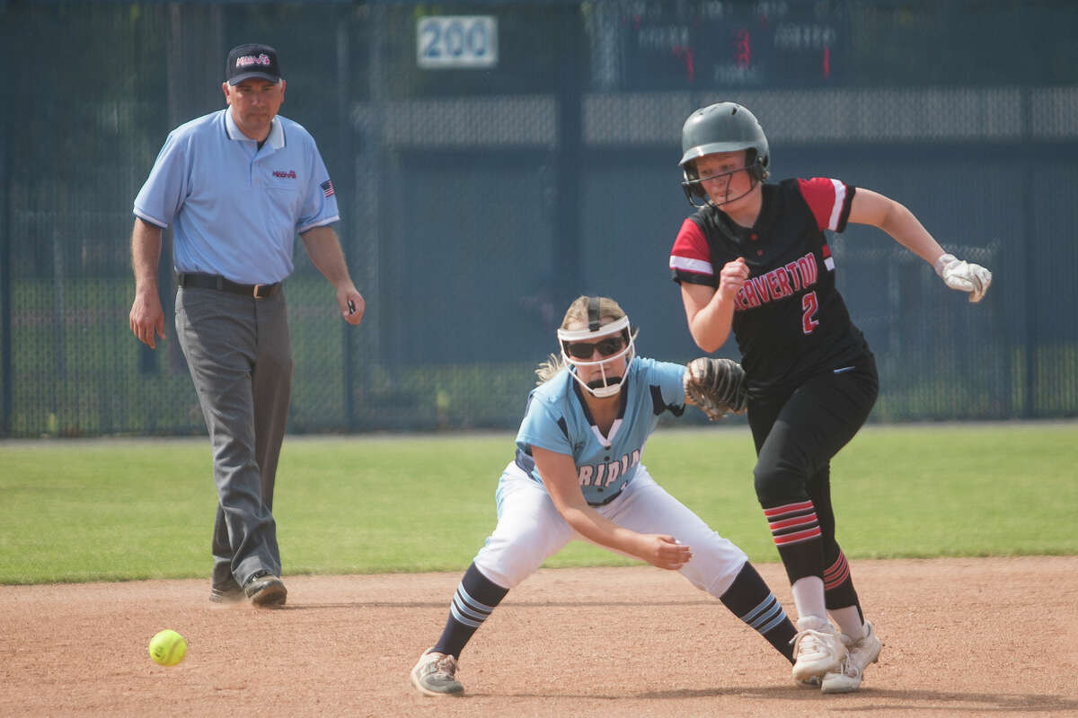 Meridian's Ally Sutton misses the ball as Beave Rayne Myers runs towards third base during their game Friday, May 21, 2021 at Meridian Early College High School. (Katy Kildee/kkildee@mdn.net)