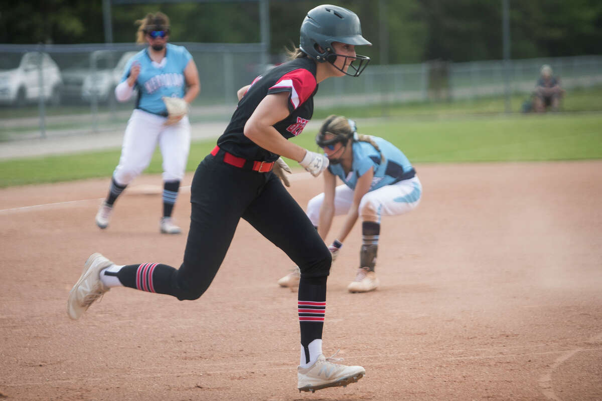 Beaverton's Molly Gerow runs toward first base during the Beavers' game against Meridian Friday, May 21, 2021 at Meridian Early College High School. (Katy Kildee/kkildee@mdn.net)