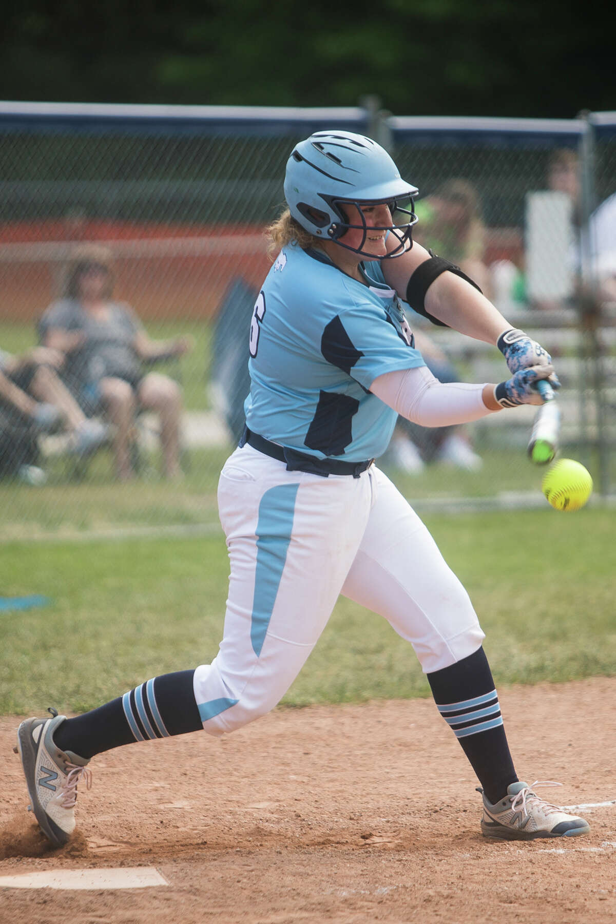 Meridian's Ashtyn Kelly swings on a pitch during the Mustangs' game against Beaverton Friday, May 21, 2021 at Meridian Early College High School. (Katy Kildee/kkildee@mdn.net)