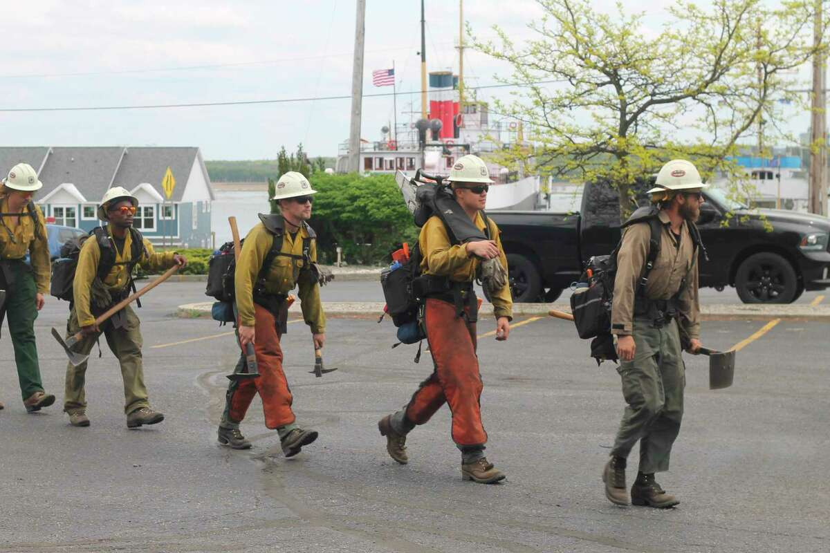 The Midewin Interagency Hotshot Crew heads to assist firefighting efforts near 74 Arthur St. in Manistee on Friday afternoon. (Kyle Kotecki/News Advocate)