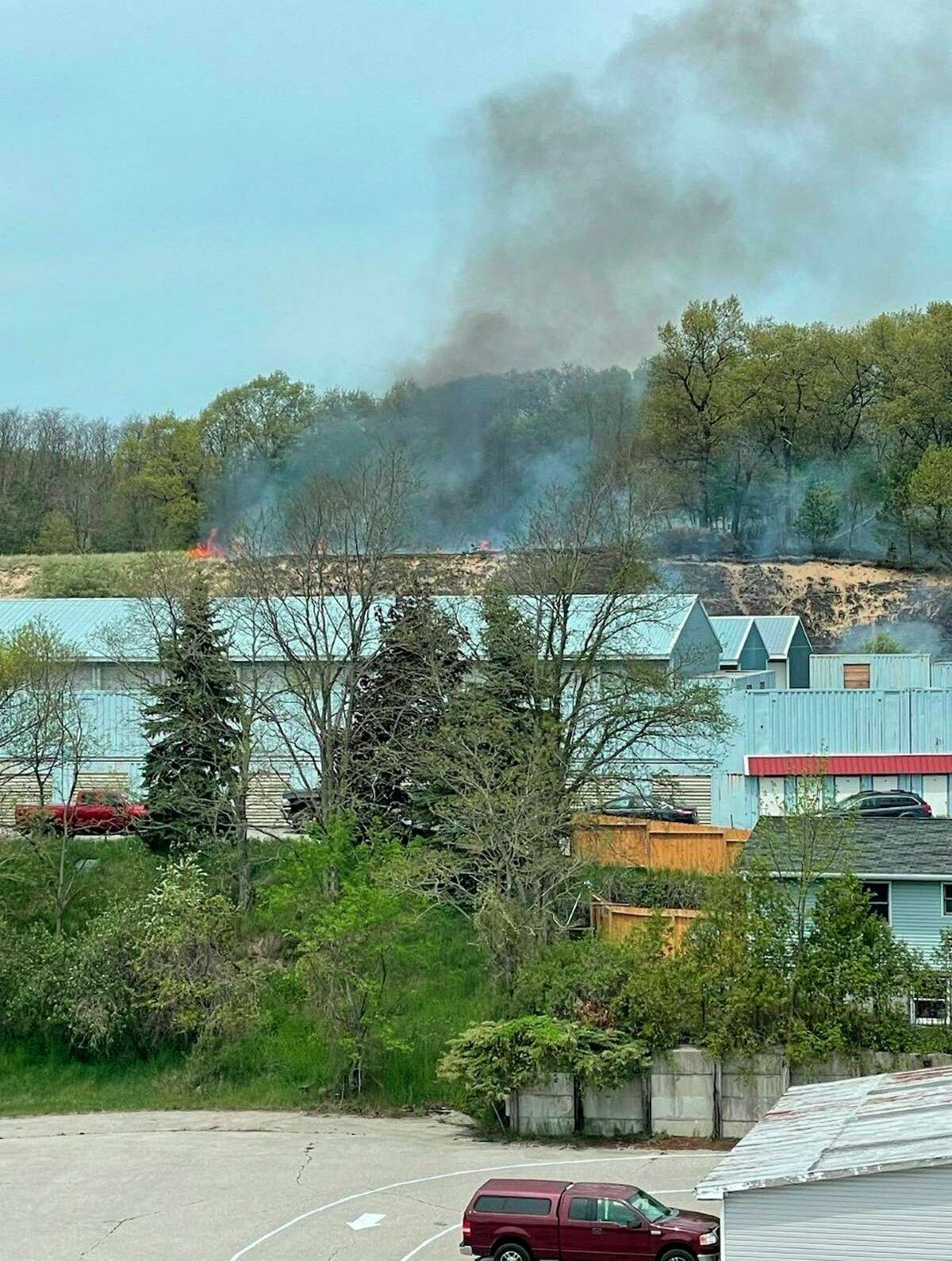 Firefighters were on the scene Friday afternoon in response to a grass fire near 74 Arthur St. in Manistee. (Courtesy photo)