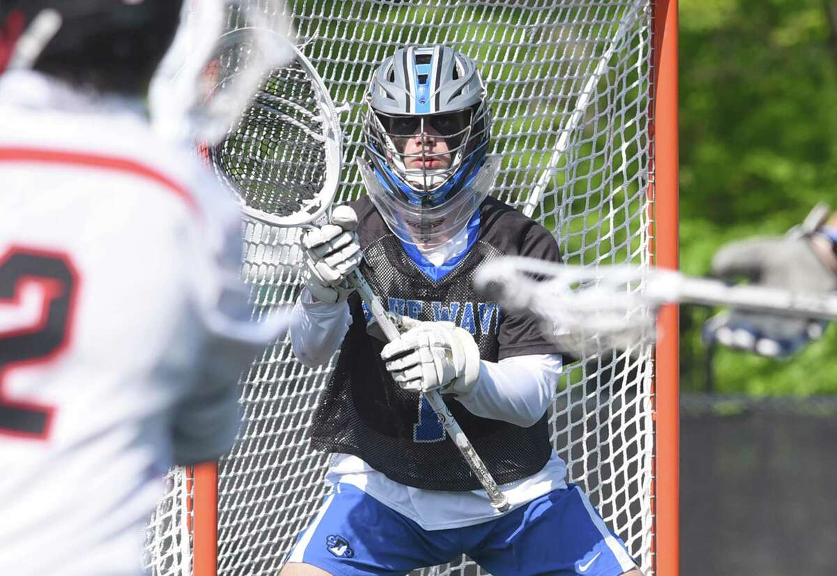 Darien goalie Andy Demopoulos (1) keeps his eyes on the ball during a game against New Canaan at Dunning Field on Thursday.
