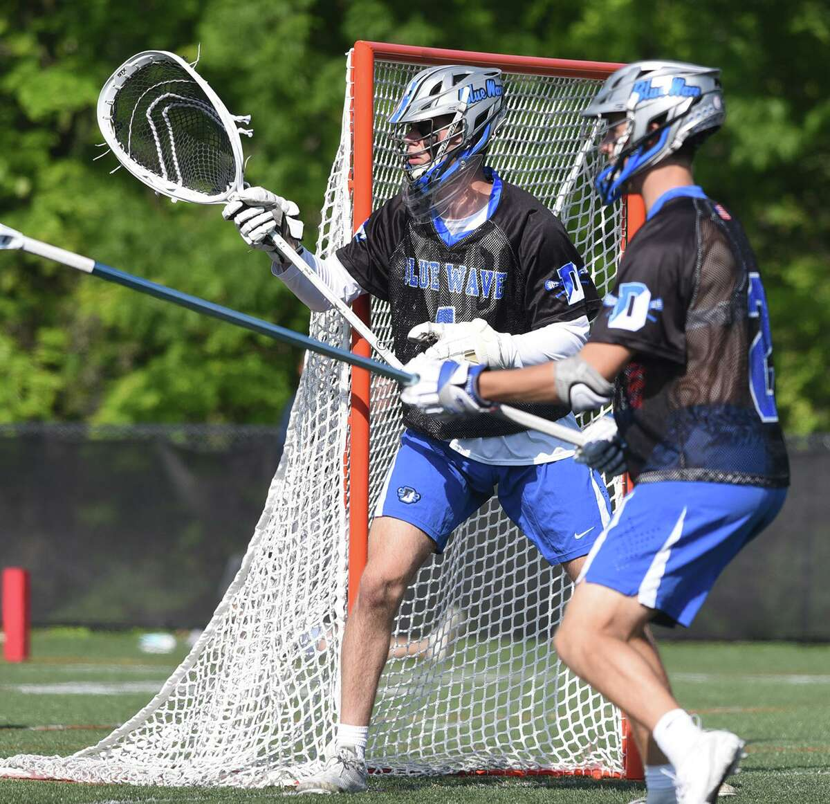 Darien goalie Andy Demopoulos (1) guards the net with help from Oliver Bolton (2) during a game against New Canaan at Dunning Field on Thursday.