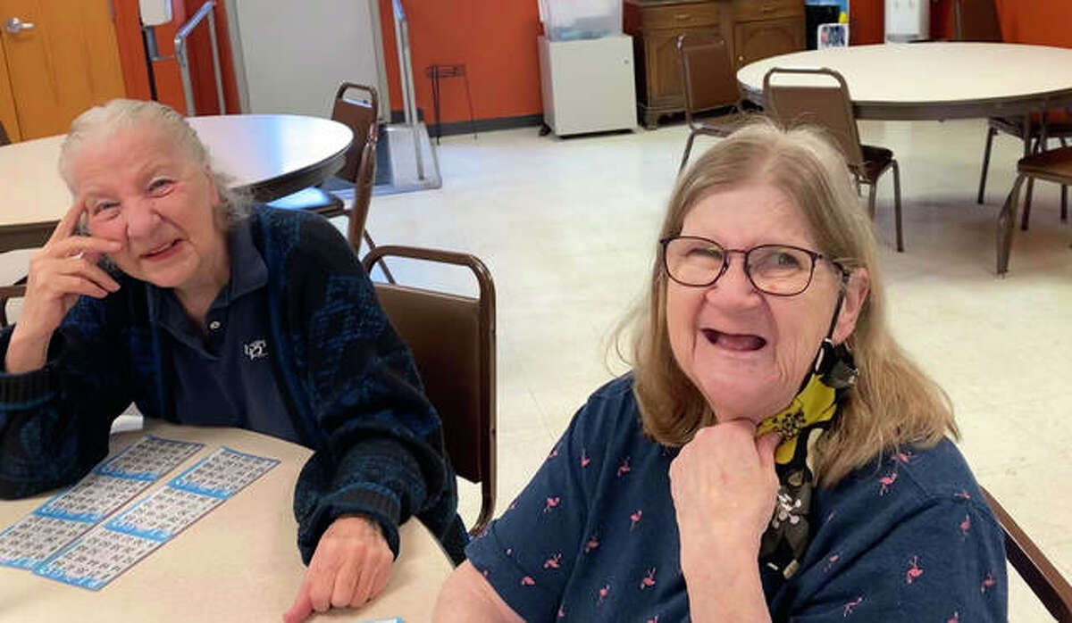 Main Street Community Center clients Edie, left, and Joanne play bingo Friday at the center. Main Street is resuming its in-person programming, which was canceled for more than a year due to the COVID-19 pandemic.