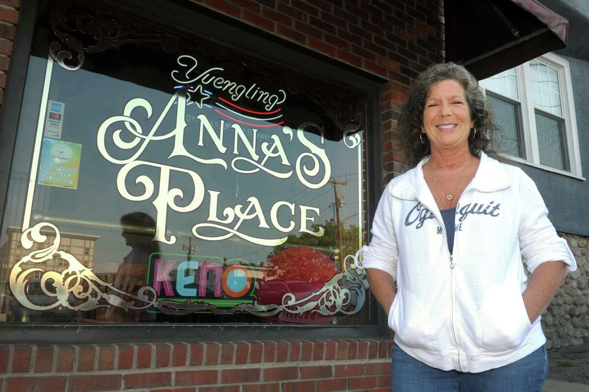 Owner Anna Valenti poses in front Anna's Place, in Shelton, Conn. May 21, 2021.