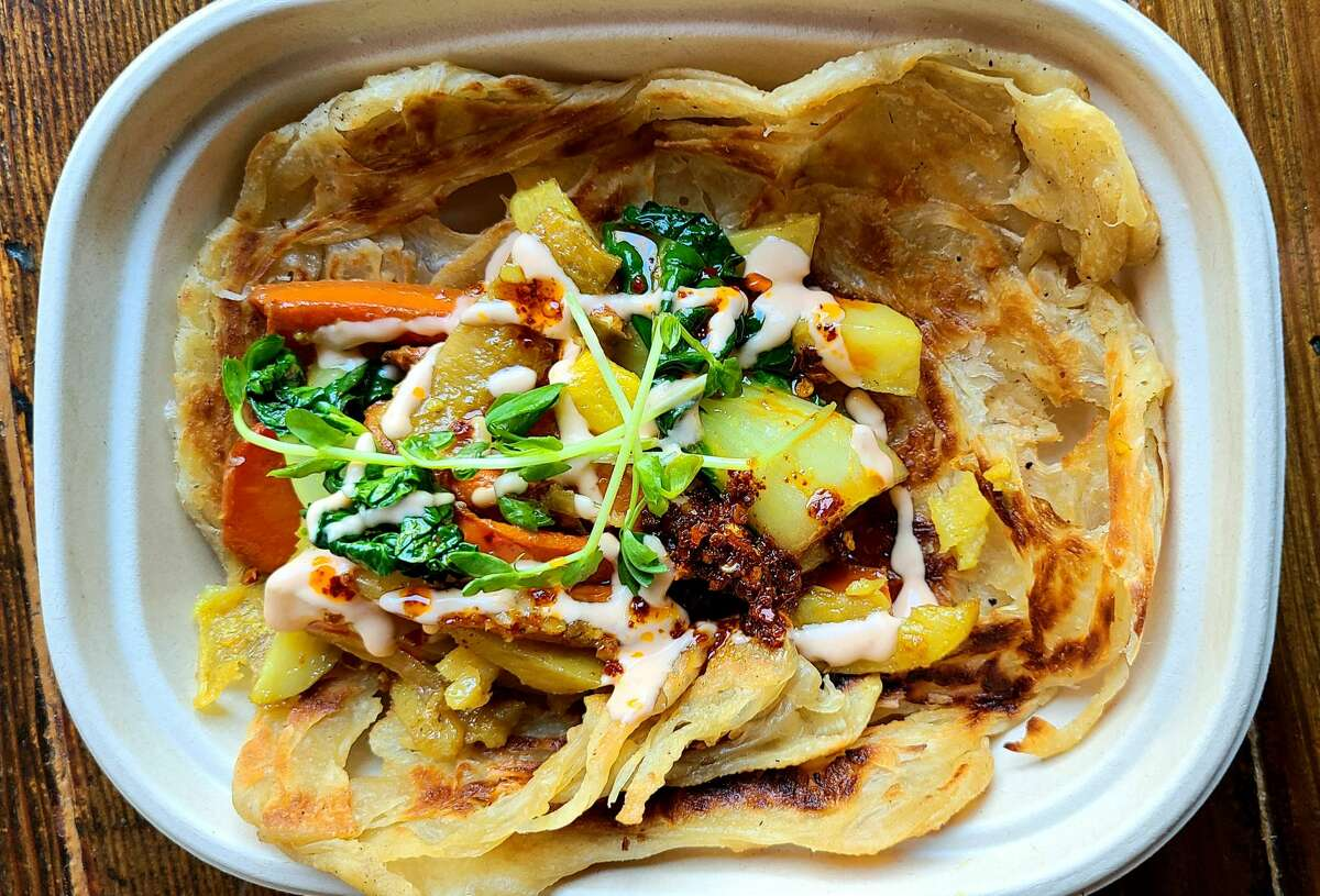 Roti topped with wok-tossed vegetables, mitmita coconut sauce and chili oil at the forthcoming Aman Cafe in Oakland.