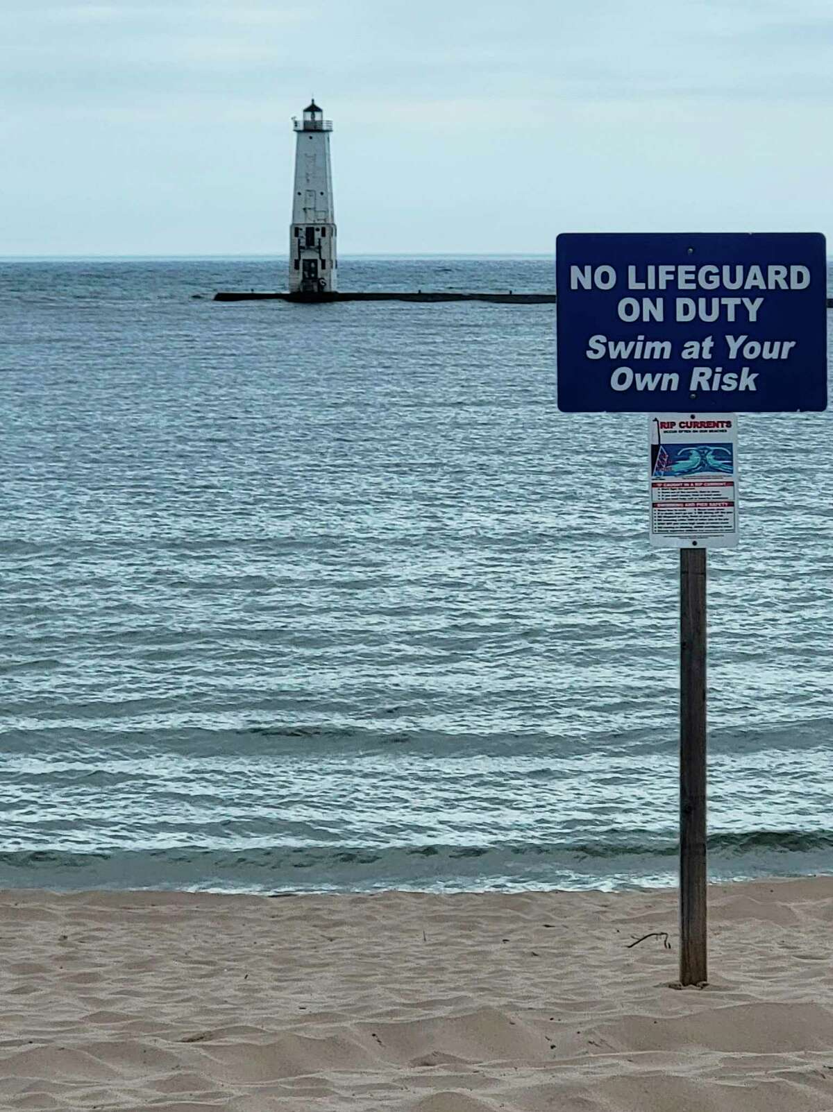 The Frankfort Aquatic Center is looking for volunteers to help make visitors to Frankfort's beach aware of a soon-to-be installed warning light system that will alert people to hazardous conditions for swimming and walking on the pier. (Colin Merry/Record Patriot)