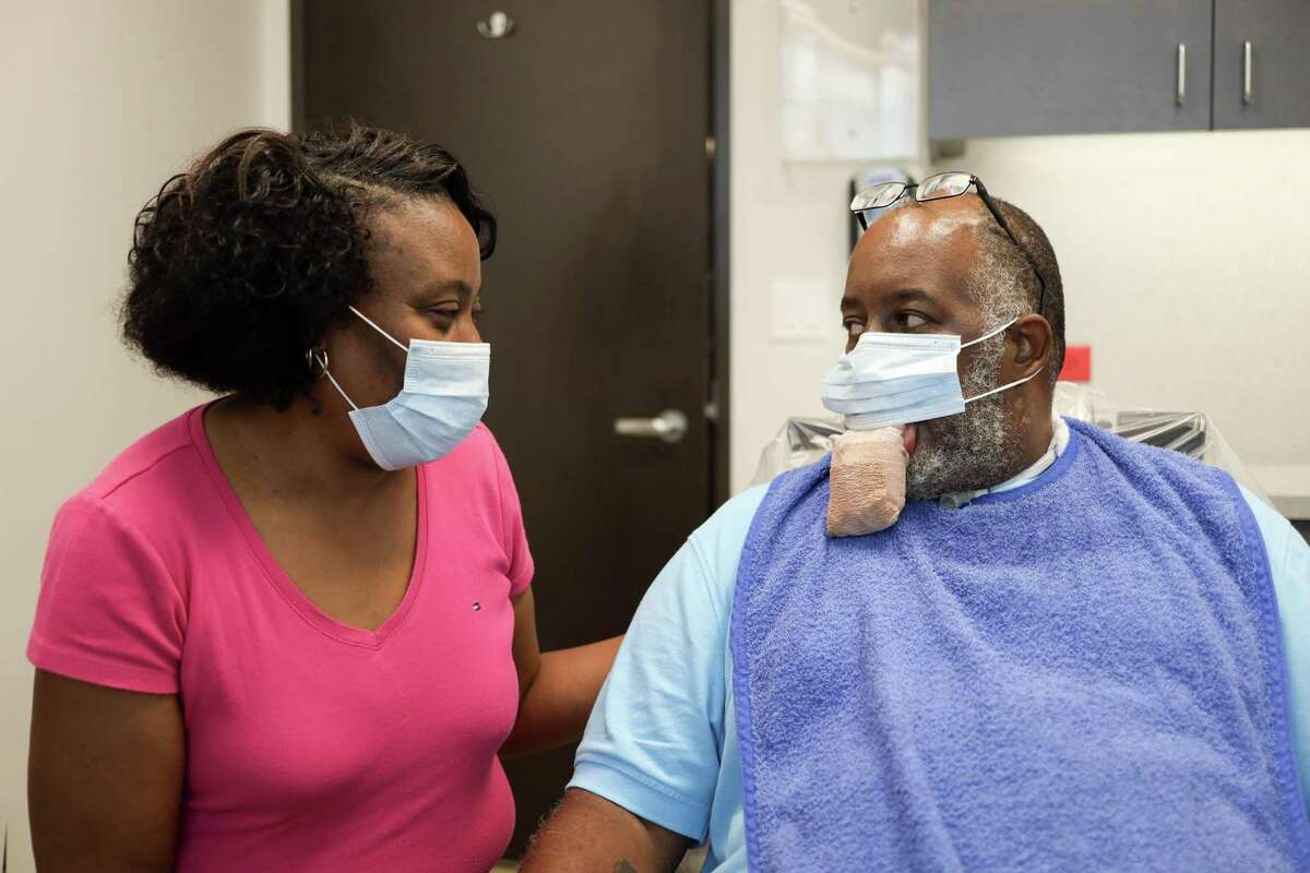 Anthony Jones and his wife, Gail Jones, prepare for a surgery to reduce the size of his tongue, which swelled severely due to a rare COVID-19 side effect. Before the surgery, Gail had to wrap her husband's tongue daily.