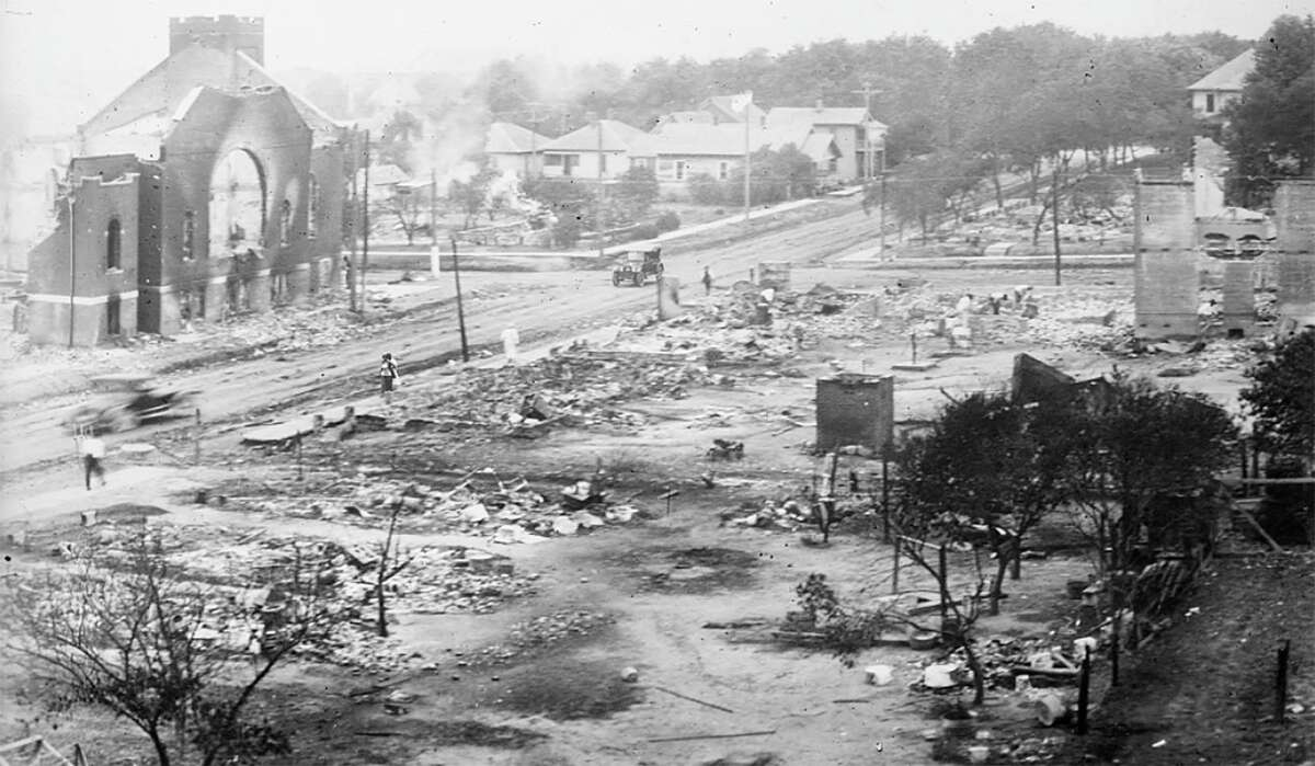 This June 1921 handout photo obtained May 19, 2021,courtesy of the Library of Congress, shows the aftermath of the burning of buildings, after the Tulsa Massacre in Tulsa, Oklahoma. - Three Black centenarian survivors of one of the deadliest US race massacres appealed to Congress for justice on May 19, 2021 after a lifetime of pain triggered by a tragedy only now coming to light for many Americans.In gripping testimony, 107-year-old Viola Fletcher, the oldest living survivor of the Tulsa, Oklahoma massacre of 1921, recalled the horrors of the attack -- and how she and others were left behind by a nation she accused of burying the past and moving on.