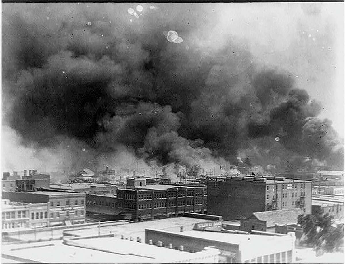 This June 1921 handout photo obtained May 19, 2021,courtesy of the Library of Congress shows smoke billowing in the Greenwood neighborhood, during the burning of buildings after the Tulsa Massacre in Tulsa, Oklahoma. - Three Black centenarian survivors of one of the deadliest US race massacres appealed to Congress for justice on May 19, 2021 after a lifetime of pain triggered by a tragedy only now coming to light for many Americans.In gripping testimony, 107-year-old Viola Fletcher, the oldest living survivor of the Tulsa, Oklahoma massacre of 1921, recalled the horrors of the attack -- and how she and others were left behind by a nation she accused of burying the past and moving on.