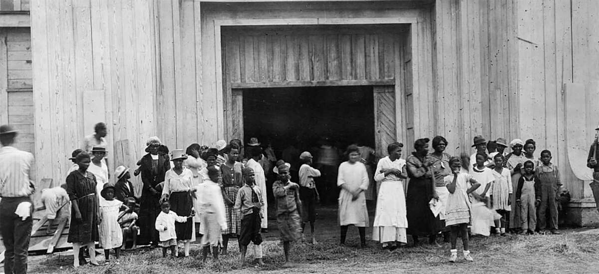 This June 1, 1921 handout photo obtained May 19, 2021, courtesy of the Library of Congress shows people standing at the entrance to a refugee camp on the fair grounds after the Tulsa Massacre in Tulsa, Oklahoma. - Three Black centenarian survivors of one of the deadliest US race massacres appealed to Congress for justice on May 19, 2021 after a lifetime of pain triggered by a tragedy only now coming to light for many Americans.In gripping testimony, 107-year-old Viola Fletcher, the oldest living survivor of the Tulsa, Oklahoma massacre of 1921, recalled the horrors of the attack -- and how she and others were left behind by a nation she accused of burying the past and moving on.