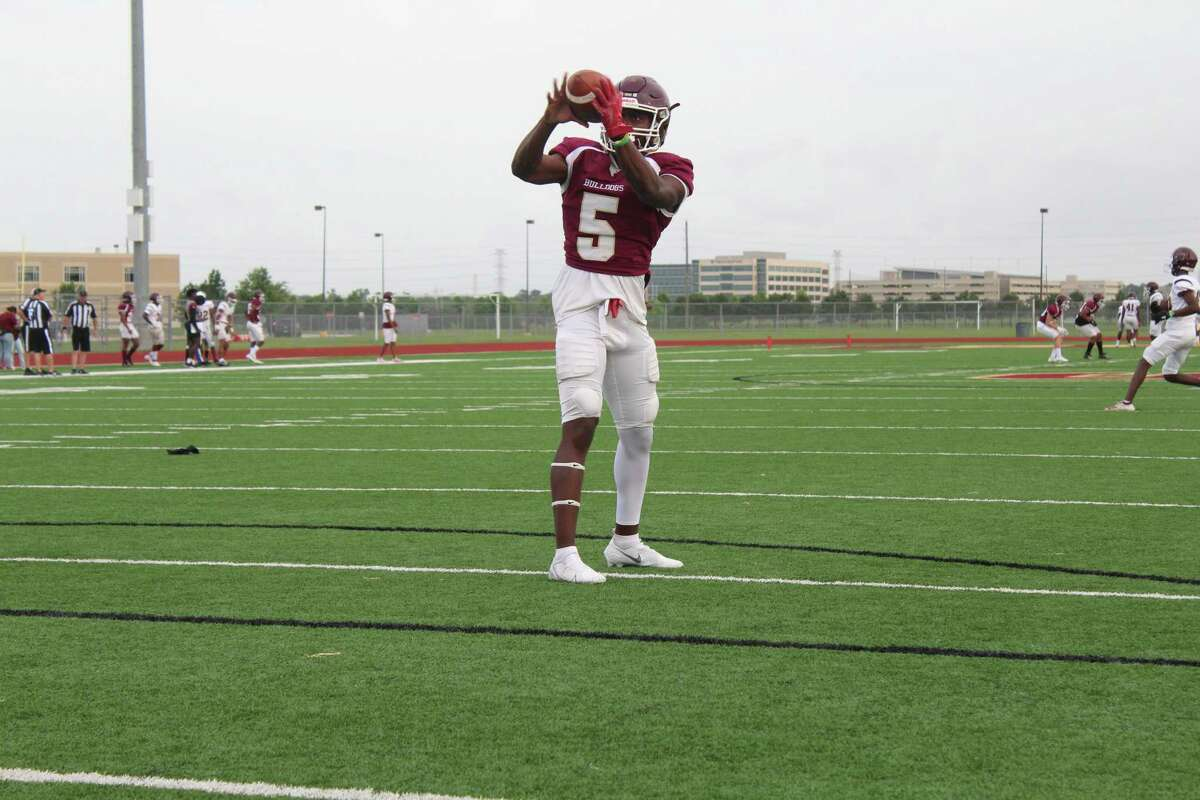 Summer Creek wide receiver Andrew Alexander warming up for the spring game.