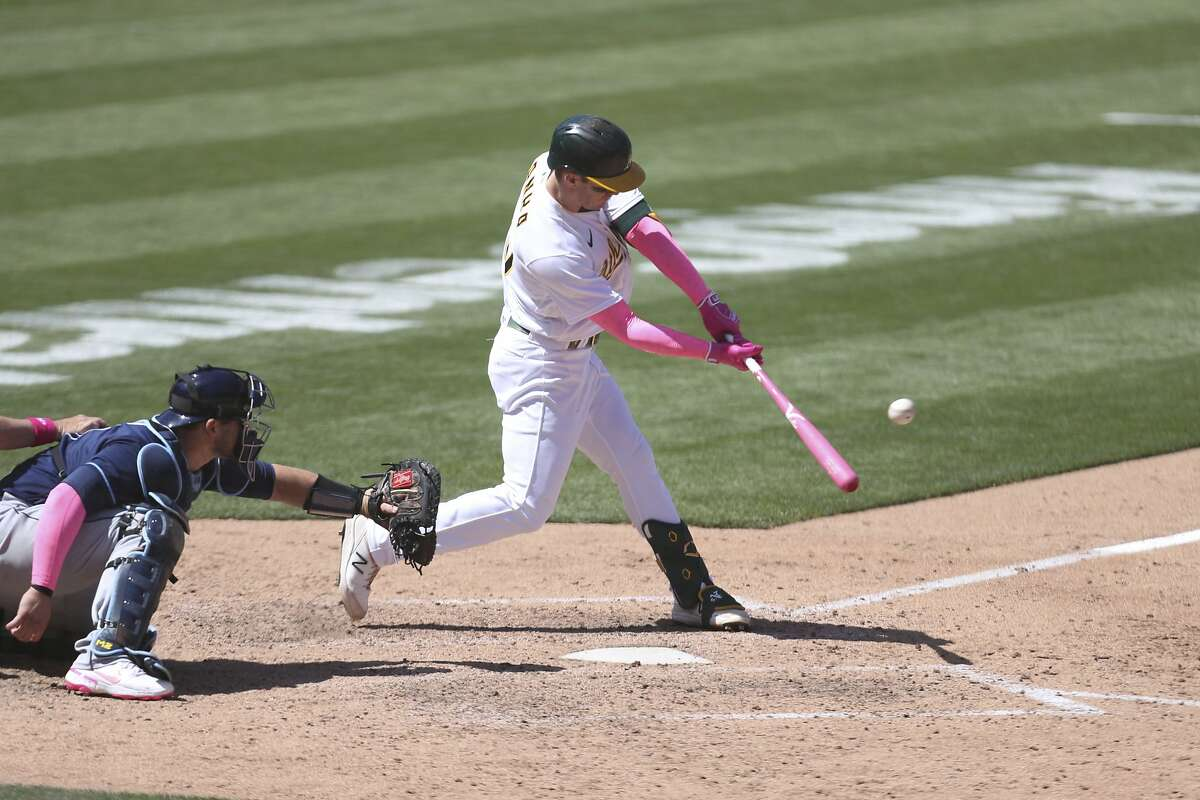 Oakland Athletics' Mark Canha bats against the Tampa Bay Rays during a baseball game in Oakland, Calif., Sunday, May 9, 2021. (AP Photo/Jed Jacobsohn)