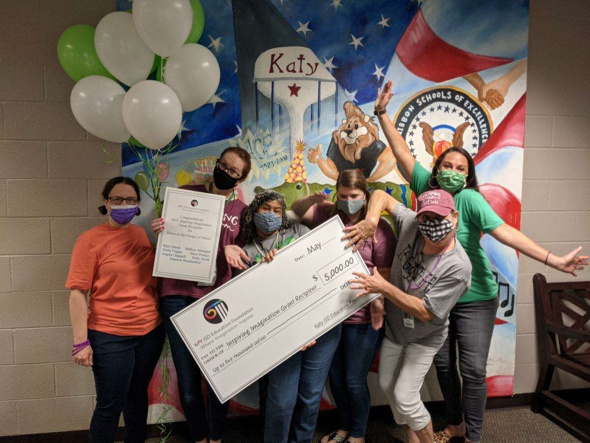 """Teachers at Mayde Creek Elementary celebrate receiving a grant from the Katy Education Foundation. The grant, worth up to $5,000, will help fund the """"Discover the Energy of Music!"""" program led by Rhea Marsh."""