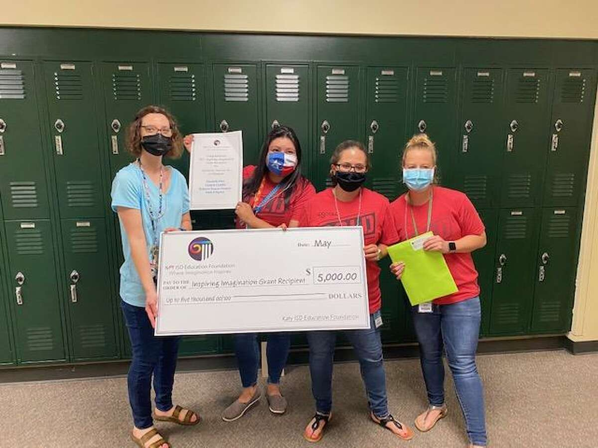 """Teachers at Mayde Creek Junior High show off their grant worth up to $5,000 from the Katy Education Foundation. The grant will help fund the """"Scholastic Success for All Students"""" program led by Elizabeth Etter."""