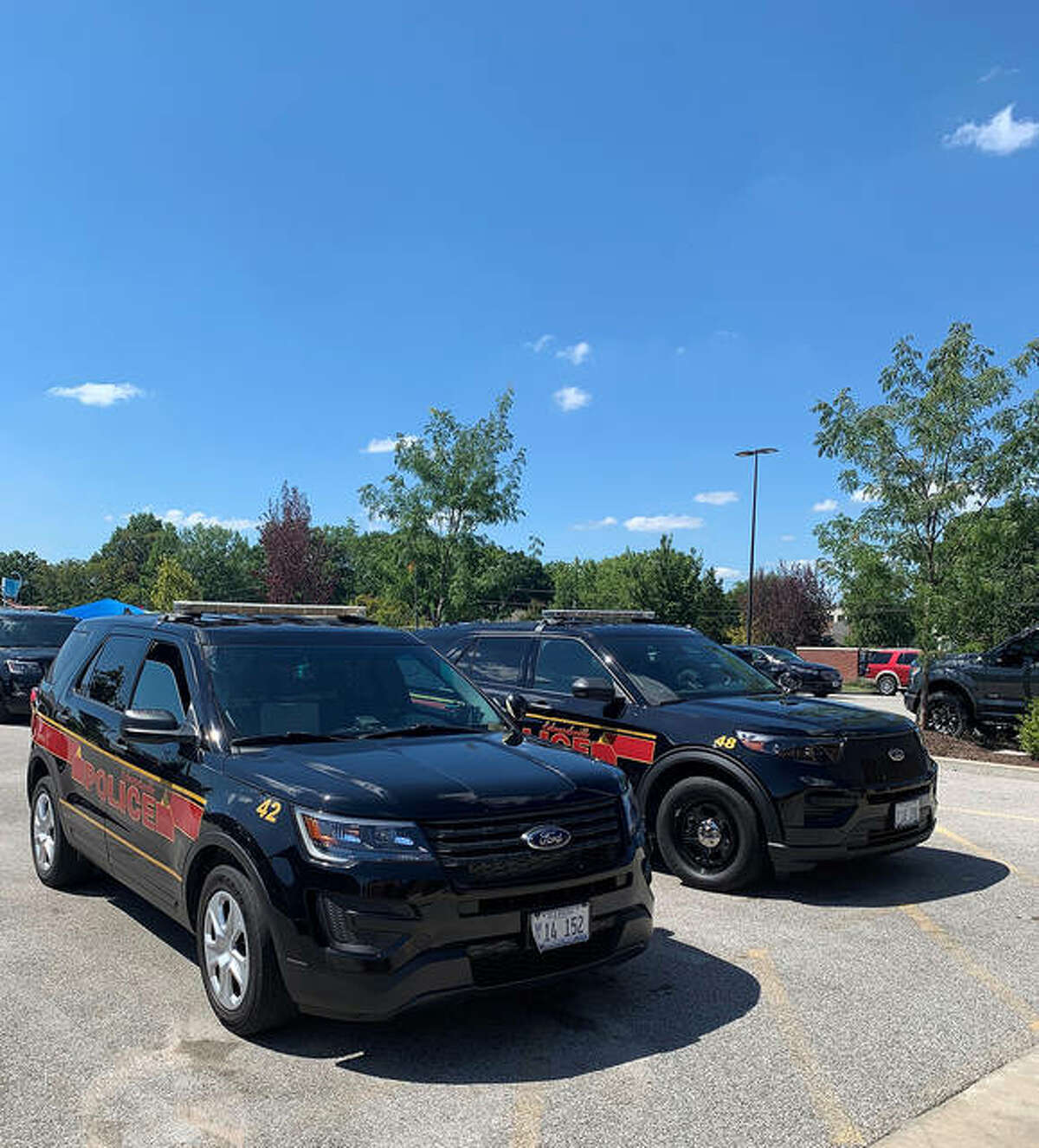 The Edwardsville Police Department has a fleet of Ford Explorer Interceptors. Some are powered by only gasoline, foreground, while others are a hybrid model, background, The department has been purchasing hybrid models since 2019.