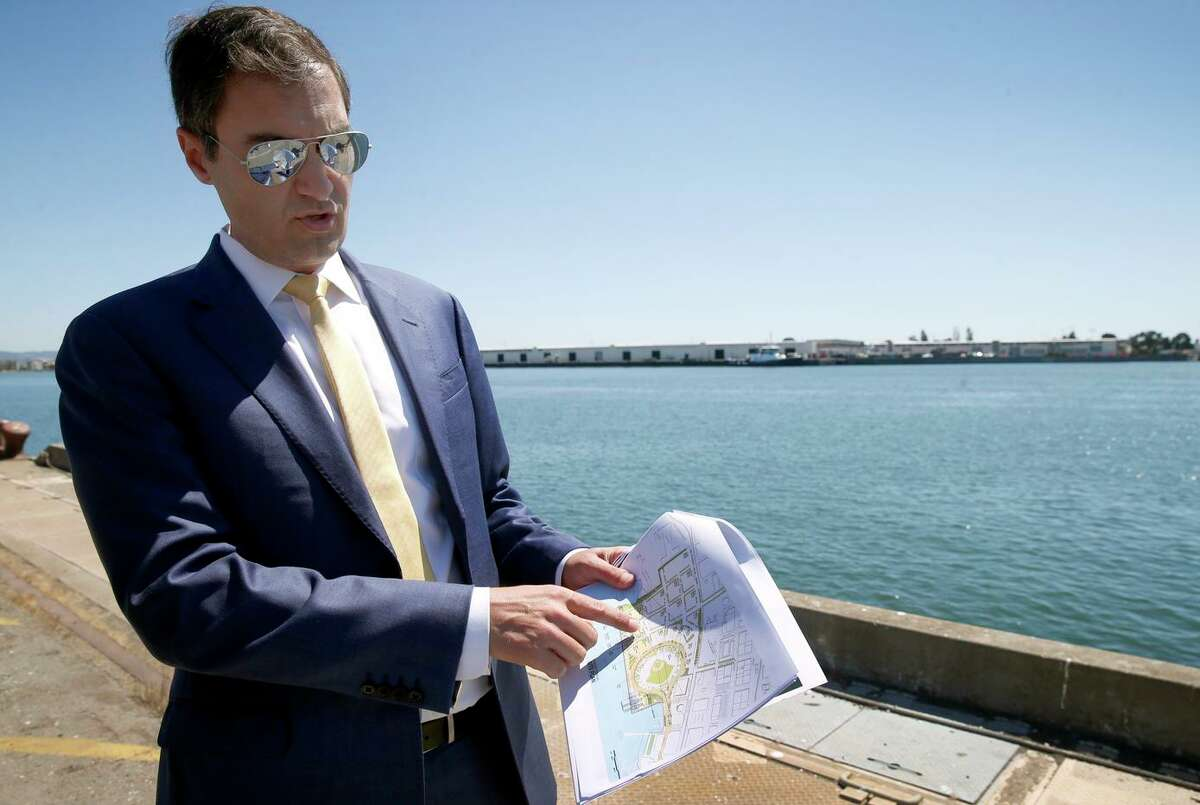 Oakland A's President Dave Kaval describes features of the development plan while leading a private tour of the Howard Terminal site in Oakland, Calif. on Tuesday, Sept. 3, 2019 where the baseball team is hoping to build its new stadium.