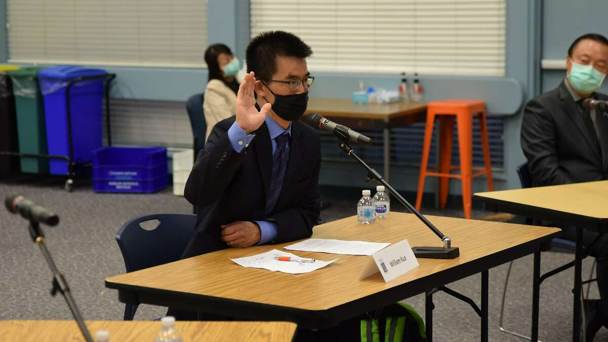 William Kuo, 51, pictured, is seen during a swearing-in ceremony after being appointed role as the Area 3 trustee for the Dublin Unified School District board of trustees - the seat left vacant by his late wife Catherine Kuo, 48.