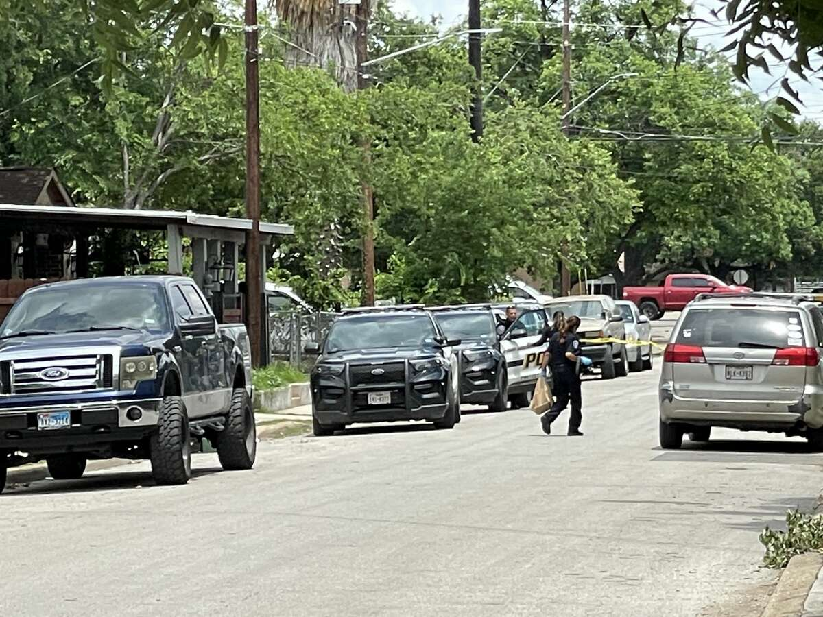 San Antonio police examine the scene Friday in the 600 block of Recio Street where a suspect was arrested hours after he allegedly fled a shooting in the 300 block of King William Street.