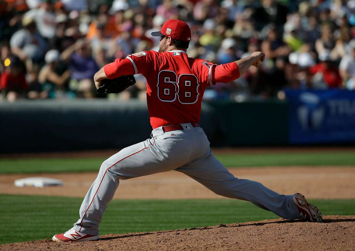 Los Angeles Angels relief pitcher Cam Bedrosian throws against the San Francisco Giants during a spring baseball game in Scottsdale, Ariz., Thursday, March 3, 2016. (AP Photo/Chris Carlson)