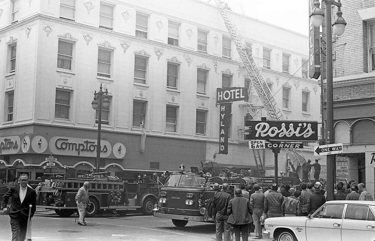 Firefighters respond to a fire at the Hyland Hotel in 1970. To the left is Compton's Cafeteria, the site of a historic queer riot in 1966. There are few known images that show the exterior of the diner, signage included.