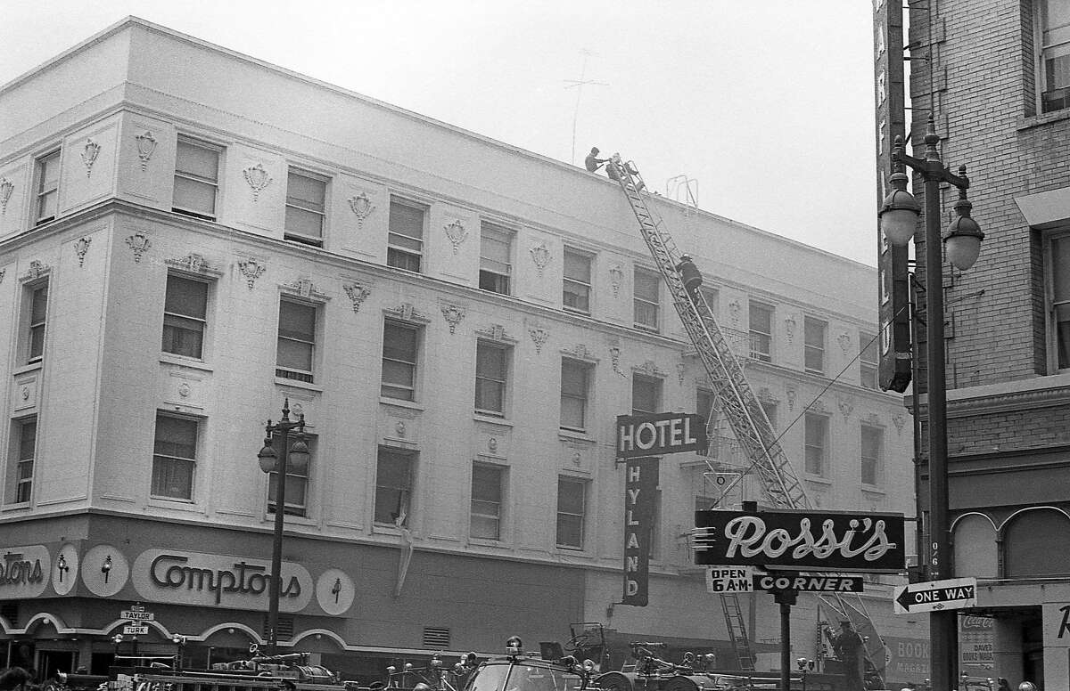 Firefighters respond to a fire at the Hyland Hotel in this photograph from 1970. To the left is Compton's Cafeteria, the site of a historic queer riot in 1966. There are few known images that show the exterior of the diner, signage included.