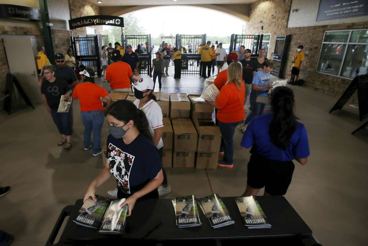 Fans enter the ballpark before a minor league baseball game between the Sugar Land Skeeters and the El Paso Chihuahuas on Friday, May 21, 2021, at Constellation Field in Sugar Land.